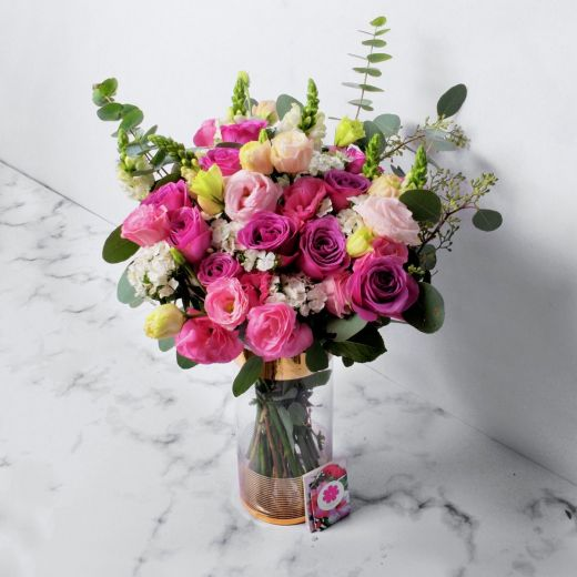 PURPLE ROSES AND PINK EUSTOMA WITH VASE