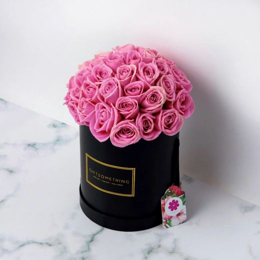 PINK ROSES IN BLACK ROUND FLOWER BOX