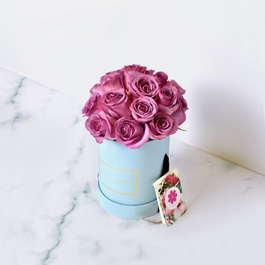 PURPLE ROSES IN BLUE ROUND FLOWER BOX