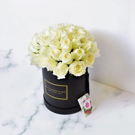 WHITE ROSES IN BLACK ROUND FLOWER BOX