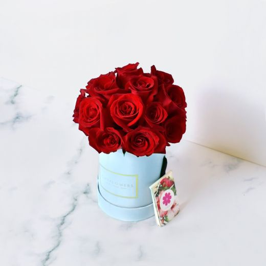 RED ROSES IN BLUE ROUND FLOWER BOX