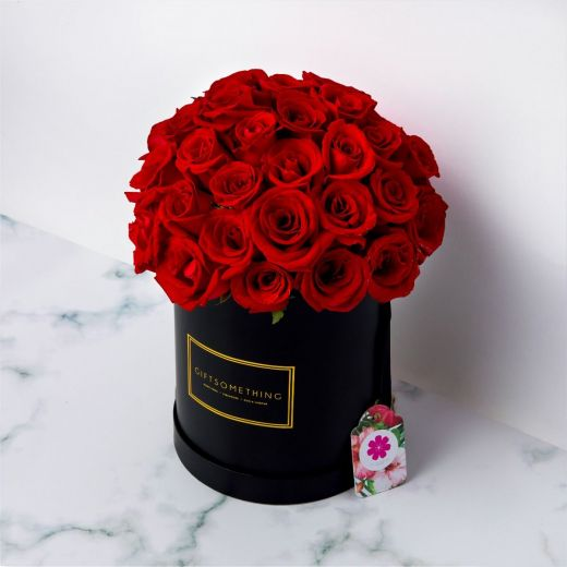 RED ROSES IN BLACK ROUND FLOWER BOX