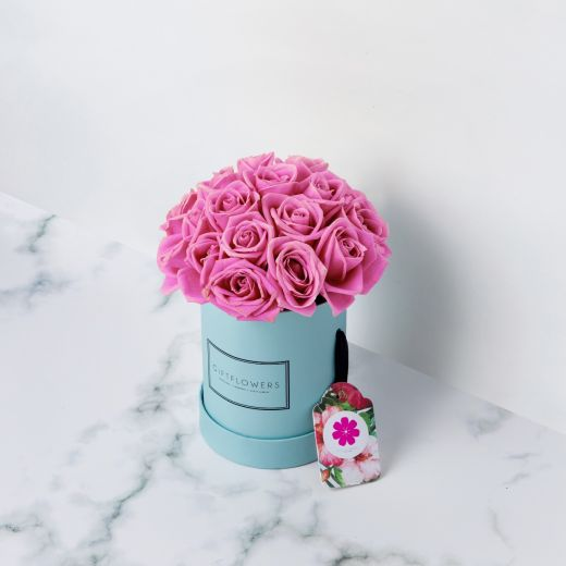 PINK ROSES IN BLUE ROUND FLOWER BOX